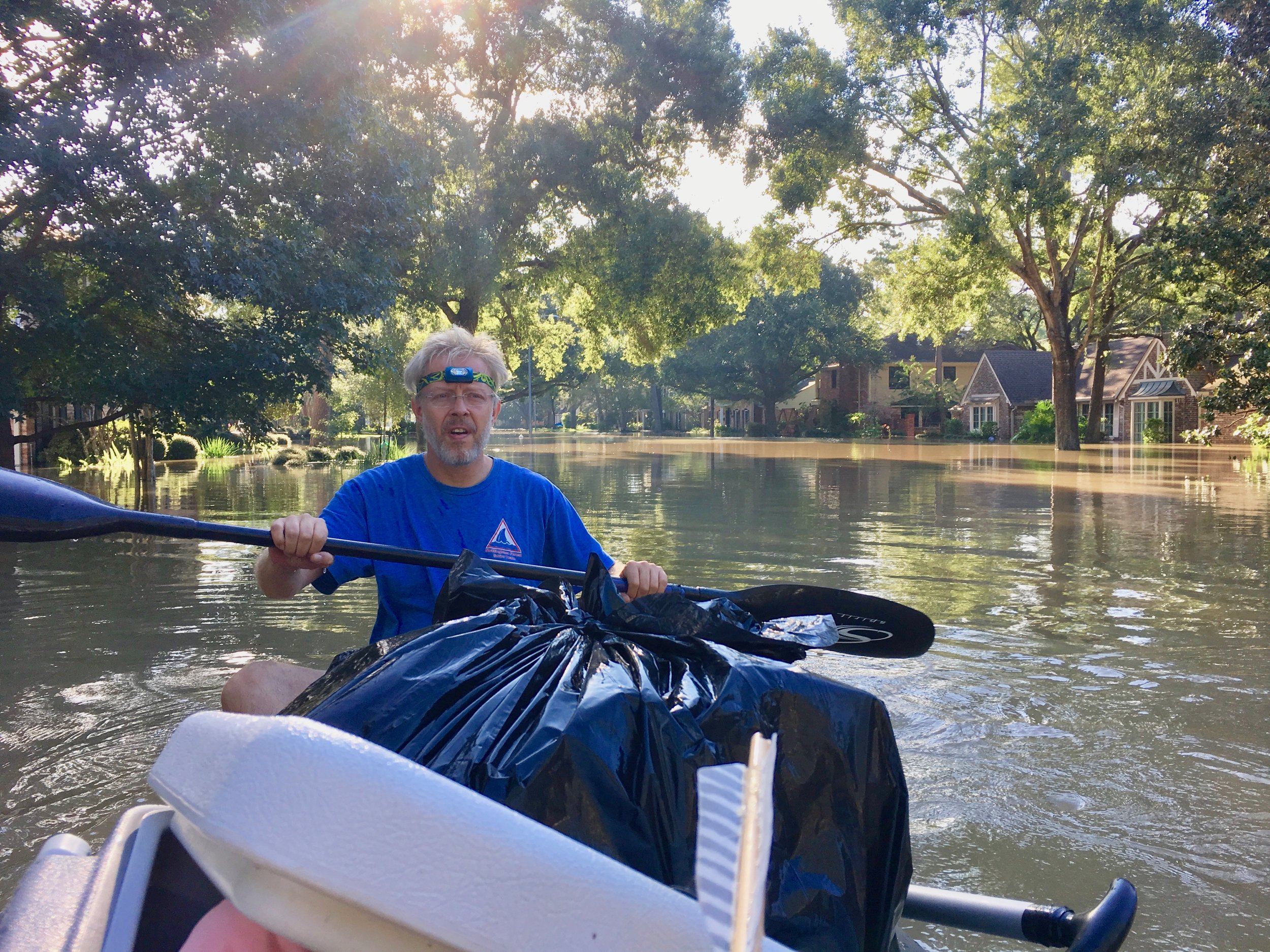AlphaGlider client recovering personal items from his family's flooded home in Houston, September 2017