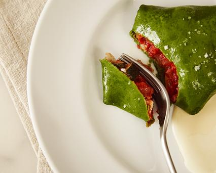 Sweet basil crepes with ratatouille and roasted garlic cream
