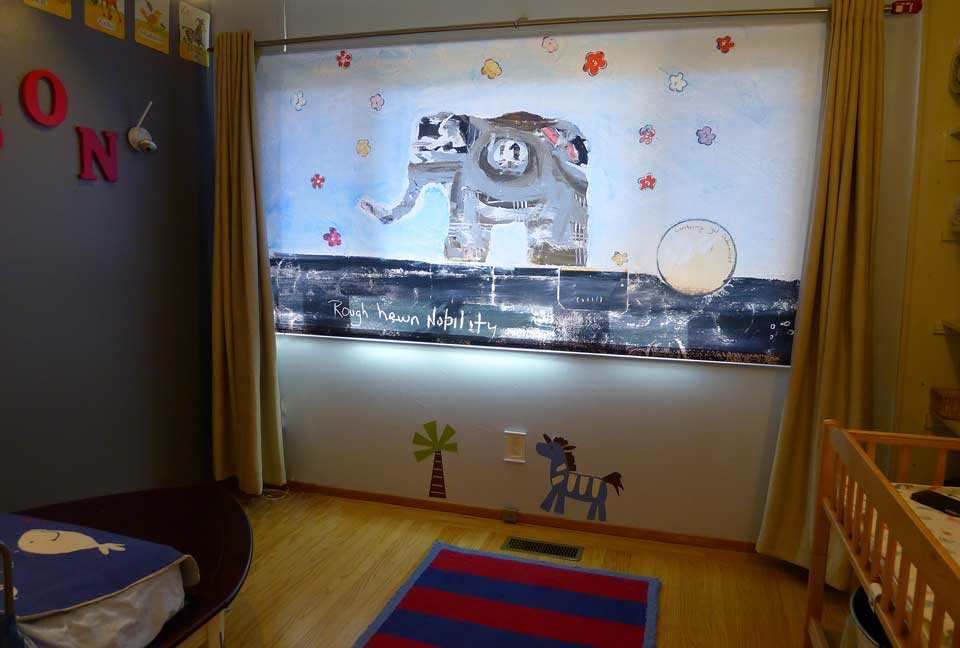 "Custom printed elephant window shade in Preston's bedroom.  ""Backlit"" fabric style with reverse roll."