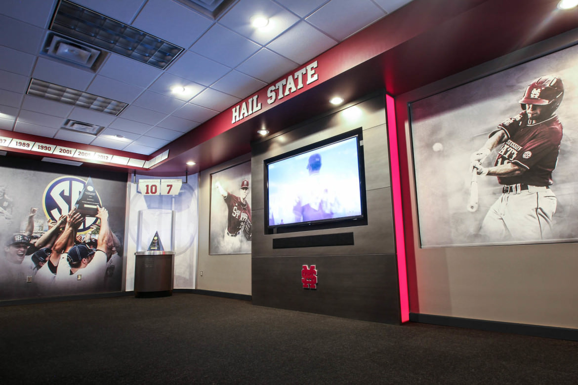 Custom printed window shades flank television in Mississippi State baseball booster club.