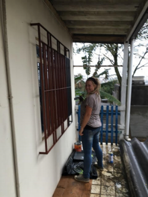 Adelyne helped painted the children's home.
