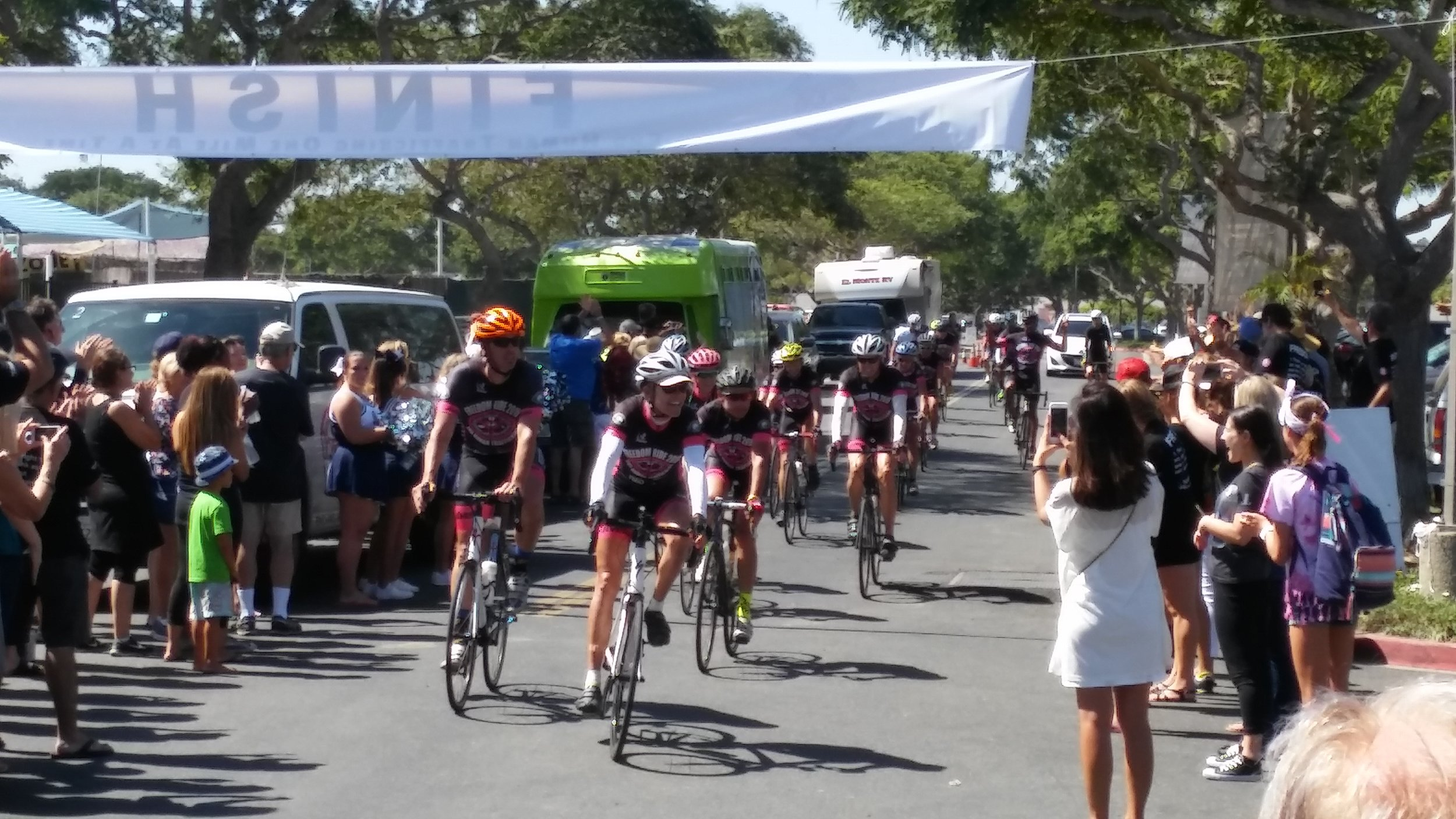 After a 15-day bike ride, the cyclists reach the Freedom Ride finish line.