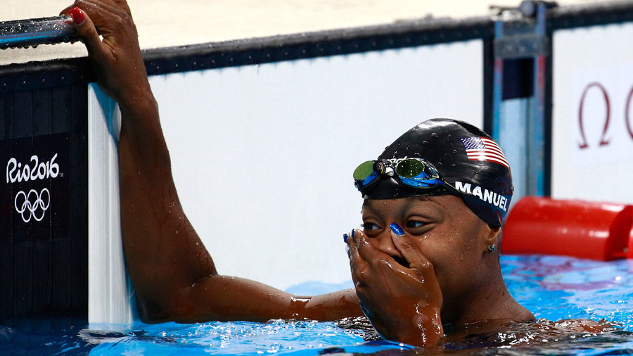 Simone Manuel wins the gold medal for the women's 100m Freestyle, sharing the top time with Canada's Penny Oleksiak.