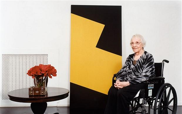 Carmen Herrera in front of her work