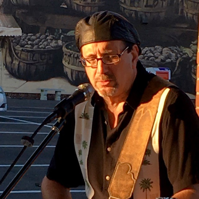Greg Greyson:   A lifetime of playing guitar and crafting original music. Soft rock with a little country, a touch of jazz, and a whole lotta living. You can catch Greyson on Facebook  here .