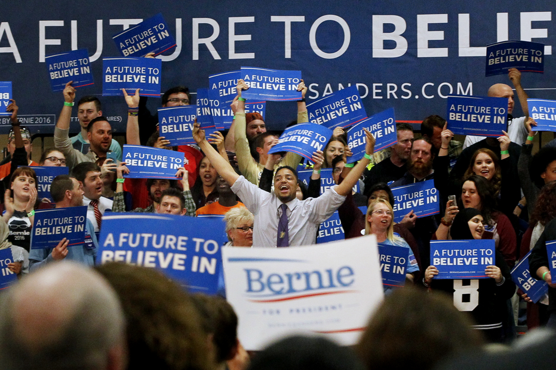 Julian Mack, center, raises both his arms up to cheer as he and other supporters welcome Democratic presidential candidate Bernie Sanders Friday, March 11, 2016, at the SeaGate Centre in downtown Toledo. Hundreds of local supporters turned out to support Mr. Sanders in advance of the Tuesday, March 15 Ohio primary as he continues his bid to win the Democratic Party nomination for President.