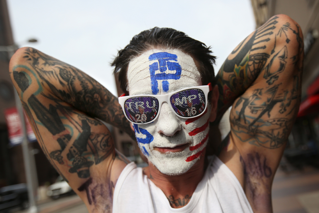 """Shane Gierke of Streetsboro, Ohio, showed of his armpits which read, """"Trump"""" and """"2016"""" as he walked near Quicken Loans Arena during the fourth and final day of the Republican National Convention Thursday, July 21, 2016, in Cleveland. Temperatures soared and Public Square, the source of many protests, was largely quiet. Mr. Gierke said he'd become a big Trump supporter after his friend was killed in a drunken driving accident by a man who told authorities he was in the county illegally."""