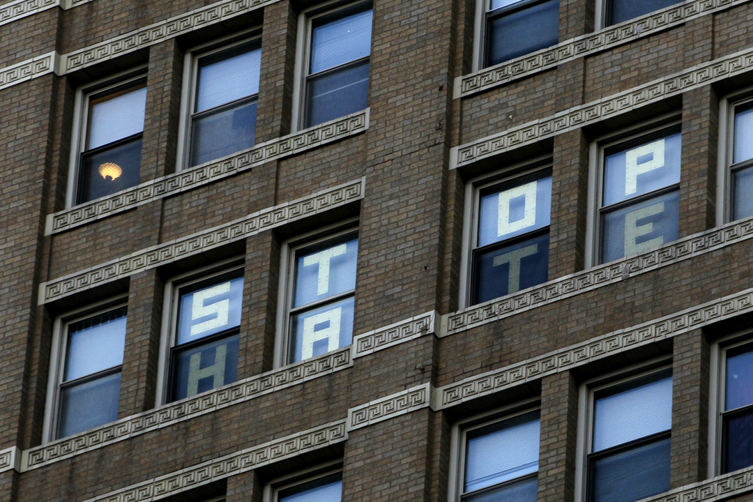 """A window in the Riverfront Apartment building reads, """"Stop Hate."""" Republican presidential nominee Donald Trump spoke Wednesday, July 27, 2016, at the Huntington Center in downtown Toledo."""