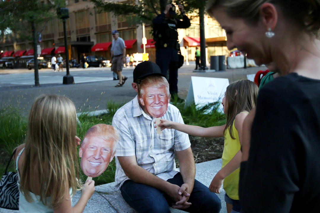 Susan, right, and Dean Siley of Richfield, center, laugh as their kids play with Donald Trump cutouts in Public Square on the third day of the Republican National Convention Wednesday, July 20, 2016, in downtown Cleveland. Among the thousands of people flocking to the attend the convention at the Quicken Loans Arena hundreds of people also turned out to protest and counter protest.