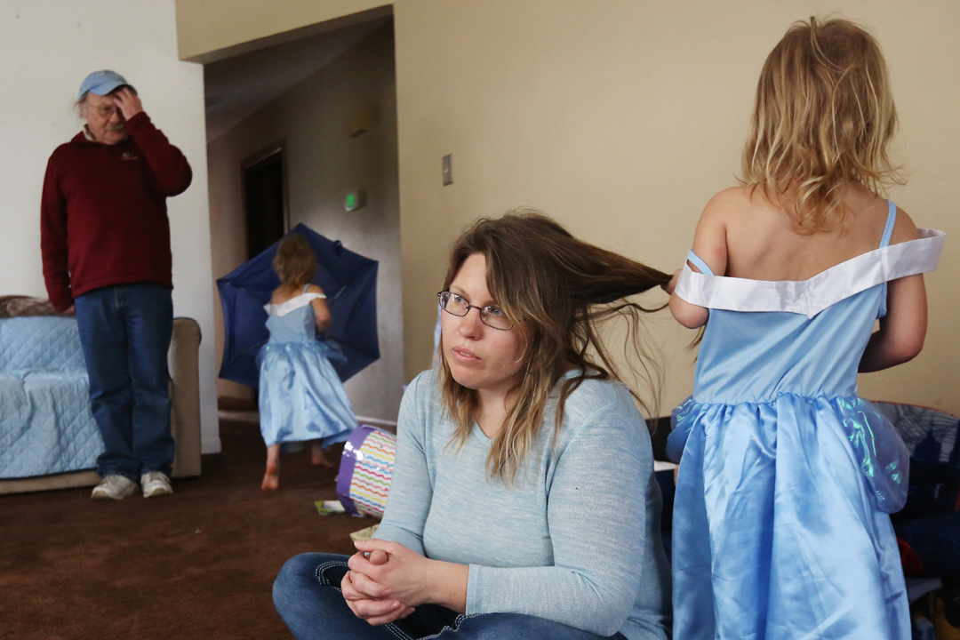 Josianne struggles with the guilt of having outlived her two eldest children, who were murdered in a brutal attack by her daughter's boyfriend in August, 2015. She and her husband Mike, not pictured, work hard to care for her remaining children, twin girls Hailey , center left, and Tiffany, right, then three-years-old, often with the help of her father David Page, left. Still, Josianne often worries she's not engaging enough with the kids.
