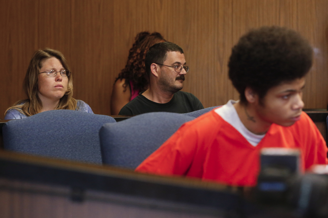 Josianne Thomas, left, and her husband Mike Thomas, center, are stoic at the plea agreement hearing for Devonte Brown, 17, right, Friday, June 3, 2016, before Lucas County Common Pleas Judge Ian English. Brown entered an Alford plea and was found guilty by Judge English of two counts of aggravated murder and one count each of attempted murder, rape, kidnapping, and failure to comply with the order of a police officer in the Aug. 10, 2015, attack on Joscelyn Jones, 16, her brother, Johnny Jones III, 14, and their mother, Josianne Thomas, 37. In an Alford plea, a defendant does not admit to committing a crime, but acknowledges evidence is sufficient for a conviction that could result in a more severe sentence. The court treats it as a guilty plea. As part of Brown's plea agreement, two counts of murder and one count of aggravated robbery were dismissed. Judge English sentenced Brown to life in prison without the possibility of parole.