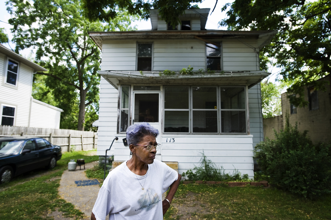 Annie Osborne stands in front of the house she has called home for more years than she can remember. Osborne lost her home to tax foreclosure after being unable to pay her taxes for two years. Though Jackson County officially took possession of her home in on April 1, Osborne stayed in the house until late July. She was unclear about whether or not she would be forced to move, regardless of the notices left on her door and the personal visit to her home made by the county treasurer.