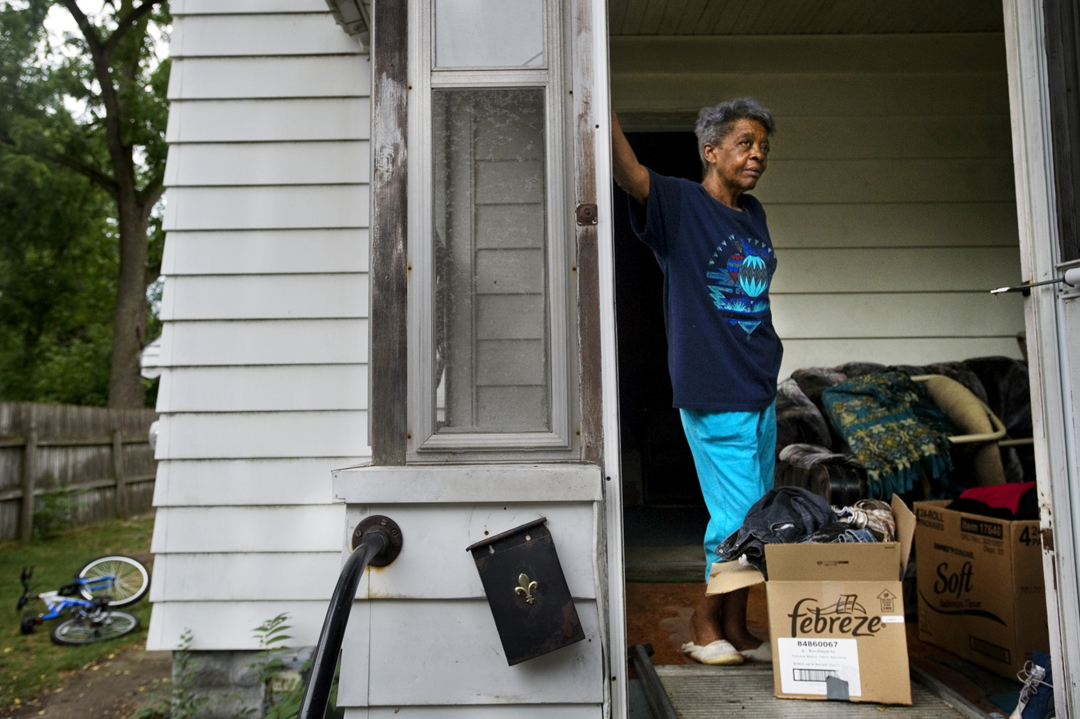 Annie Osborne takes a break in between carting boxes out of her former home in Jackson. Tax foreclosure, an increasingly common issue in Jackson County, often claims homes fully owned by their occupants. Though Annie's family had owned her home outright for several years, her inability to pay her taxes ultimately lost the house.