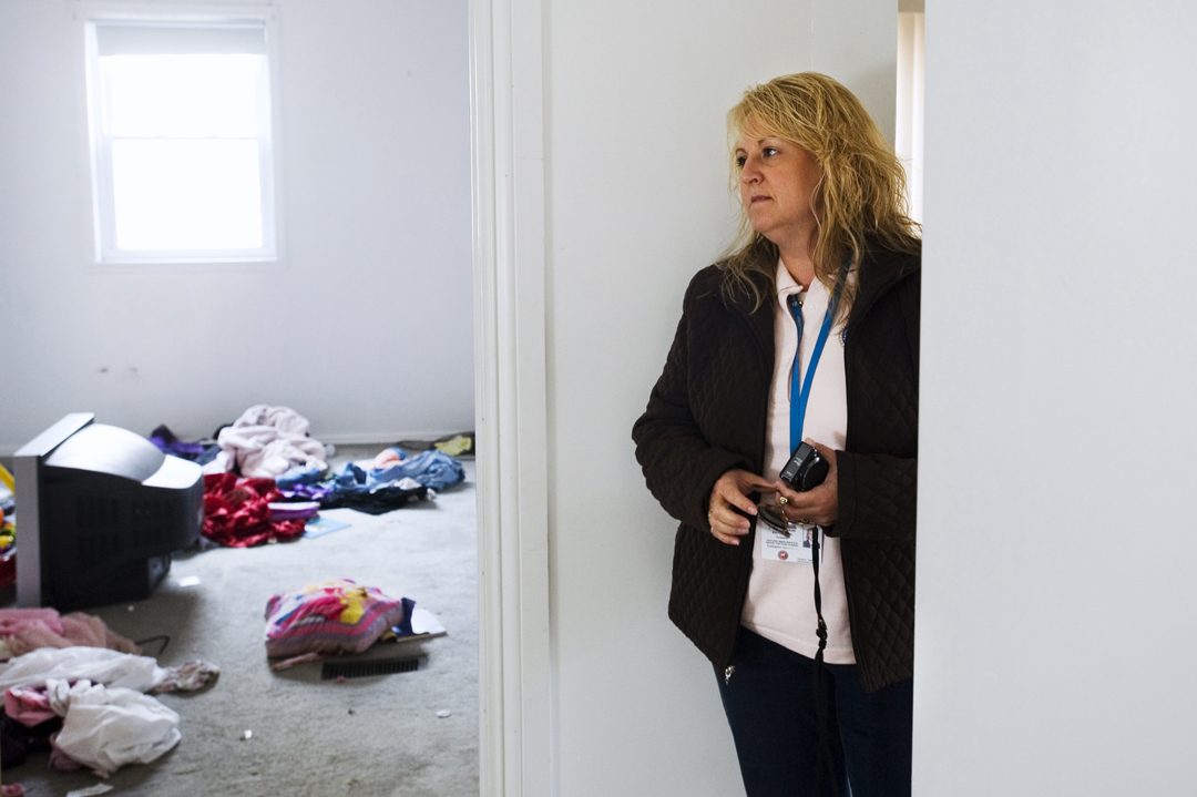 Karen Coffman, Jackson County treasurer, glances around a house filled with the personal effects of the last residents while making the rounds after the yearly tax foreclosure acquisitions by the county. Many people simply leave behind most of the possessions when they lose their homes. Though they aren't under any obligation, Jackson County does clean out the homes and work on their upkeep during the months they're in the county's possession.