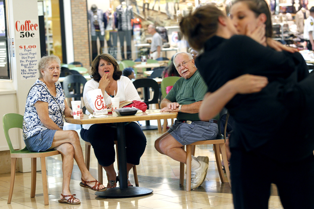 "Wanda Flory, of Swanton, center, watches with Terry, left, and her husband Richard, center right, who declined to give their last name, as Thea Grabiec, right, kisses Sarah Shovan, at the Westfield Franklin Park Mall in Toledo. Graviec and Shovan were participating in ""National Same Sex Kiss Day at Chick-fil-A,"" a protest staged in response to Wednesday's ""Chick-fil-A Appreciation Day."" Flory, who had waited in line for three hours on Wednesday to purchase Chick-fil-A in solidarity with President Dan Cathy's comment that his company is supportive of, ""the Biblical definition of the family unit,""  said her support was about free speech. ""It isn't an issue over homosexuals versus non-homosexuals,"" she said. ""He's a citizen of his country and has the right to free speech."""