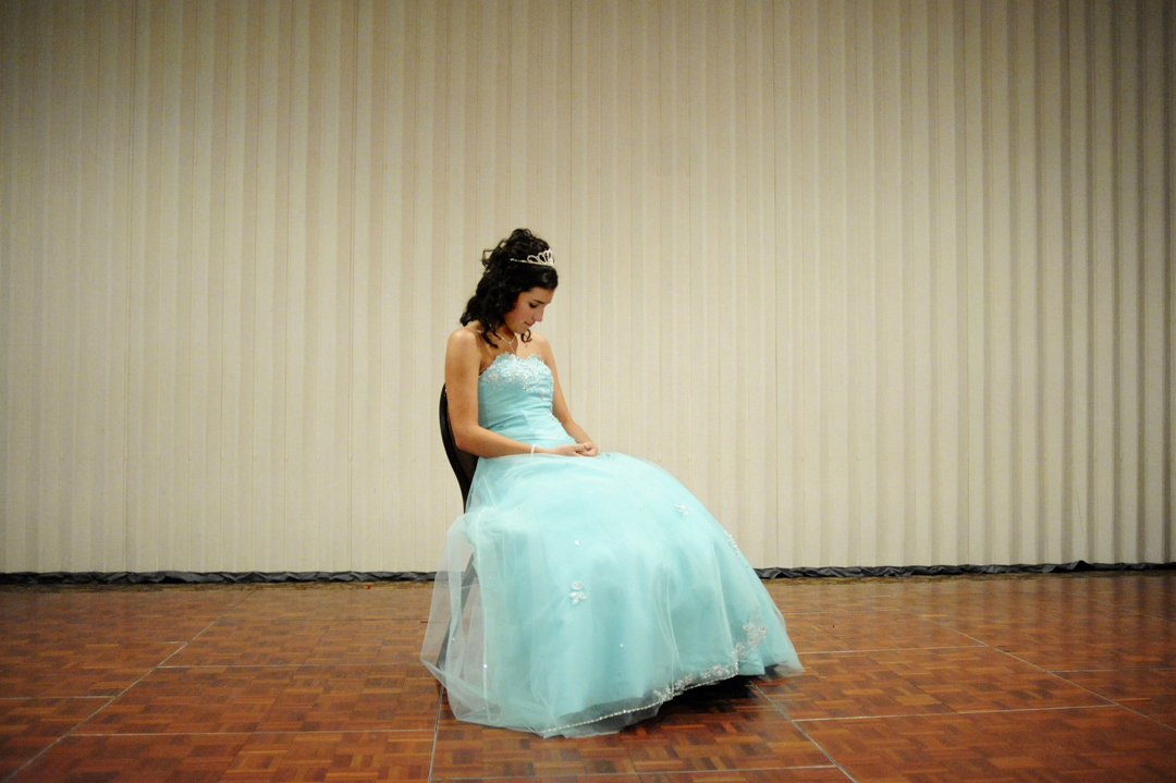 Clara Male, then 14, takes a moment to herself while waiting in front of 150 guests for her father to bring over her high heels, which symbolize her ascension into young womanhood on her 15th birthday. As the only Hispanic girl in her class to have a Quince Años celebration, Male had to write letters to the parents of schoolmates she wanted on her court, explaining the traditional Latin American ceremony.