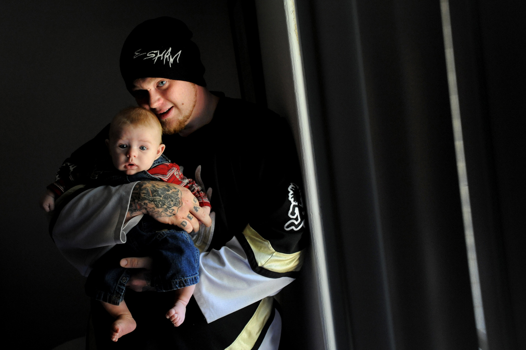 Greg Stone holds his 3-month-old son, Malaki, in his apartment just outside of Jackson. Stone is an aspiring hip-hop artist and self-professed Juggalo, or fan of the band Insane Clown Posse. Before turning to music Stone had briefly run a local backyard wrestling tournament and had a stint as a mall Easter Bunny. Stone says the birth of his son has inspired him to pursue his own music.