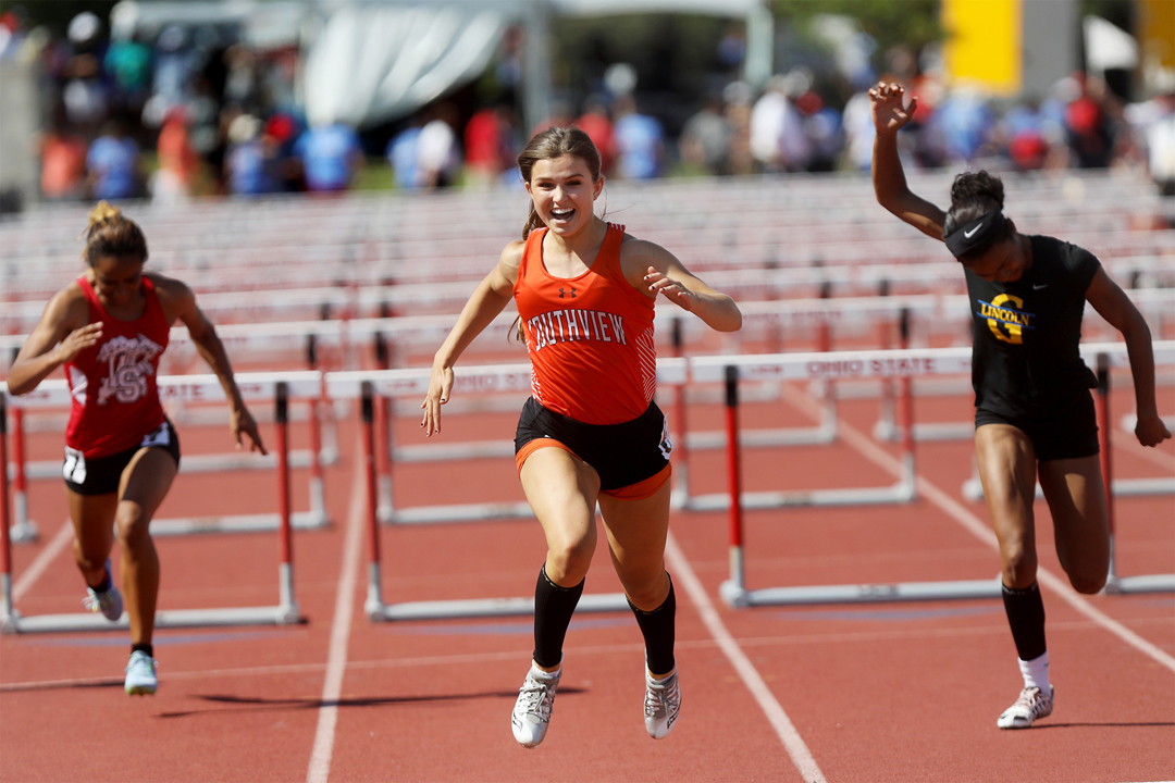 Southview's Lauren Micham smiles as she crosses the finish line to win the Division I 100 meter hurdles at the OHSAA 43d Annual Girls State Track and Field Tournament Saturday, June 3, 2017, at Jesse Owens Memorial Stadium in Columbus. Her time of 13.66 seconds broke the stadium record and put her in second place for the all-time state record in all divisions.