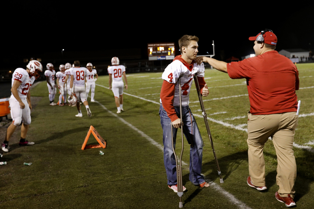 Eastwood's senior Cade Boos is embraced as his teammates head in at halftime during the Friday, October 6, 2017, at Otsego High School in Tontogany. Boos, three-sport standout, fractured his eg four plays into the team's season-opener. He is supporting his team from the sidelines during a great season. Eastwood beat Otsego, 39-0.