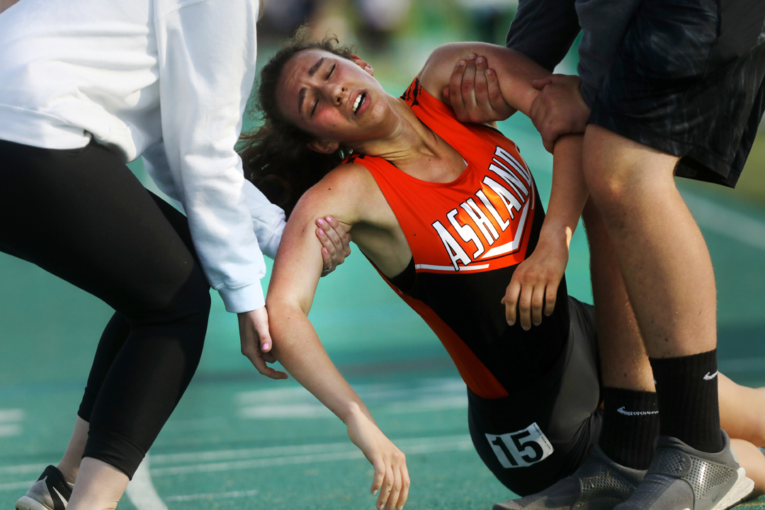 Ashland's Healther Jamieson is carried off the track after collapsing at the finish line of the 1600 Meter Run at the Division 1 Region 2 Track and Field Championship meet Friday, May 26, 2017, at Amherst Steele High School.