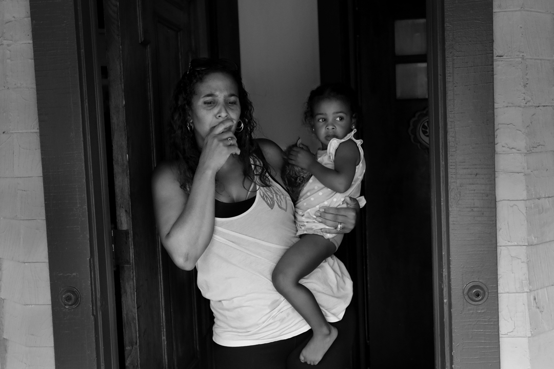 Angela Williams holds her daughter Angelina, 2, as she expresses her concerns about lead paint in her rental house Tuesday, August 15, 2017, in Lakewood. Their home was one of nearly 90 in Cuyahoga County for whom the Board of Health has issued Orders of Eviction. Many rental properties continue to be leased to new tenants despite the orders of eviction and abatement, often leaving new residents vulnerable to lead poisoning or homelessness if they are removed from the property suddenly.