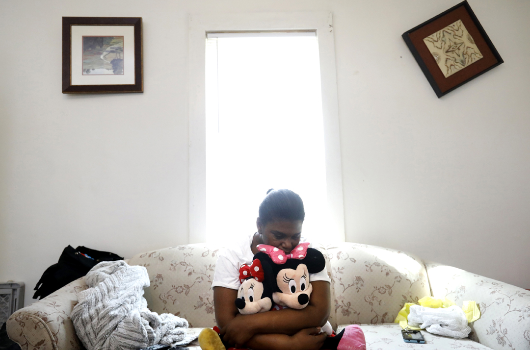 """She was our oxygen,"" Kendra Hunter, 40, said as she clutched Minnie Mouse dolls belonging to her granddaughter Serenity Hunter, 1, who died April 4, 2018, after allegedly being hit and thrown into the couch, pictured, at her home in Toledo. Joshua Herron, 30, the boyfriend of Serenity's mother, is charged with the murder. Prosecutors allege Herron was responsible for Serenity's fatal injures when he was watching the toddler alone on Easter Sunday. Serenity's homicide is the third case in 2018 where a mother's partner is charged with killing a young child."