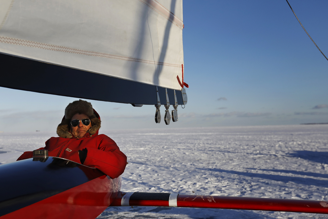 Les Lashaway, a member of the Toledo Ice Yacht Club, sits in his 1960 Renegade ice boat as the sun sets over the frozen shoreline of Lake Erie Saturday, January 6, 2018, in Point Place. Cold temperatures have helped to freeze the bays and rivers in the area, opening them up for various kinds winter sporting. The yacht club plans to race the boats Sunday, January 7, 2018.