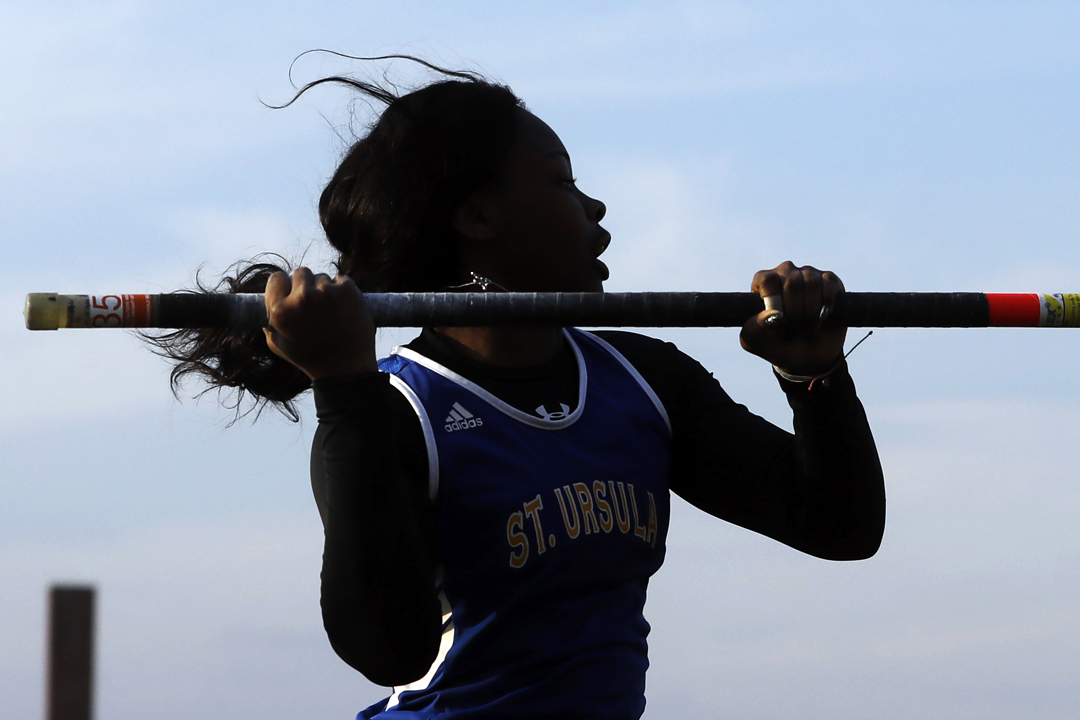 St. Ursula's April Galloway attempts nine feet, six inches in the pole vault Friday, April 27, 2018, at the Nancy Erme Relays track meet at Whitmer High School.
