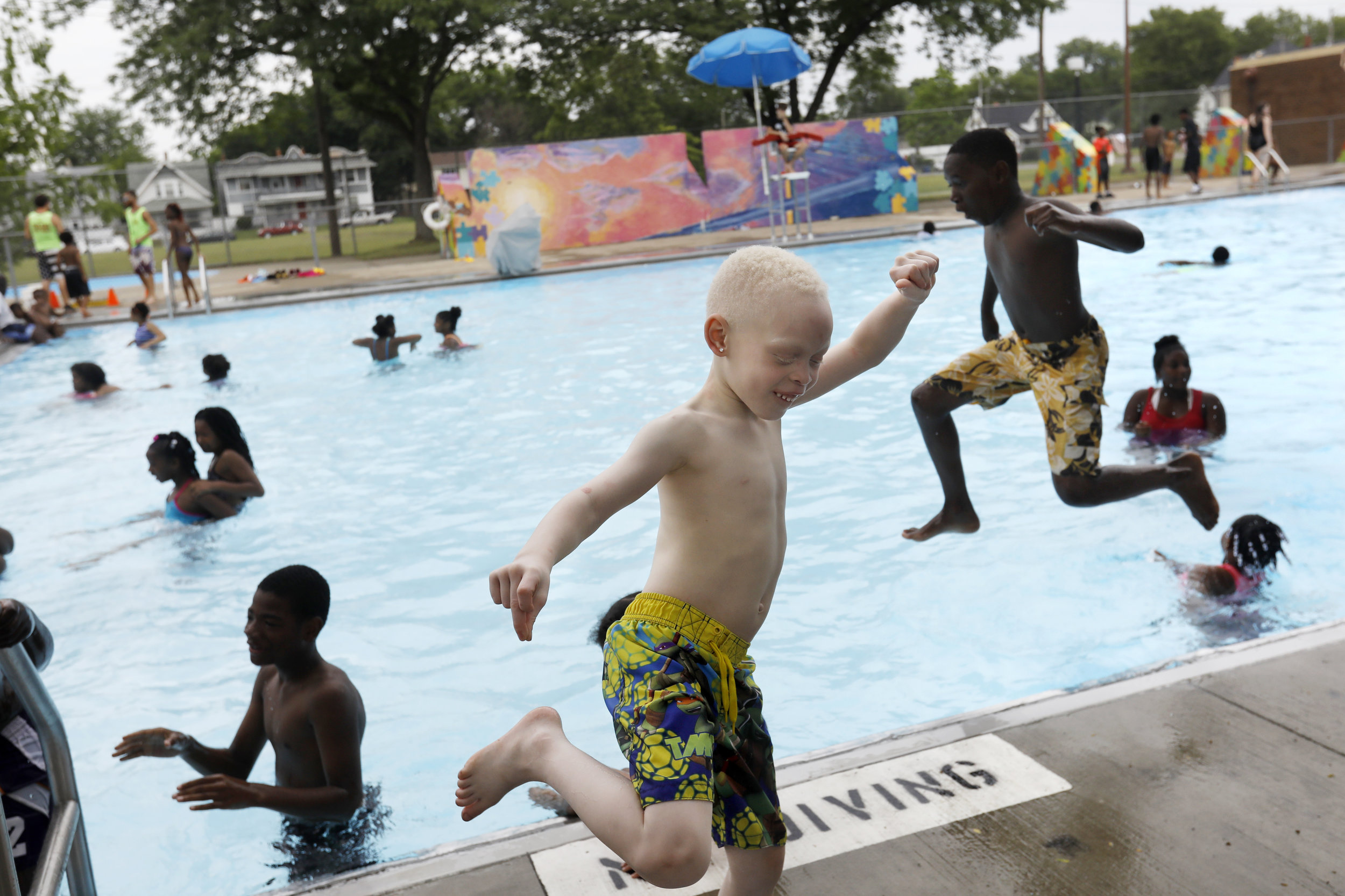 Karmero Sims, center, dances to music playing as other children jump into the newly-opened Roosevelt Pool during the seventh annual Smith Fest June 16, 2018, in Smith Park in Toledo. The festival featured horse rides from the Toledo Horsemen Club, a number of sports lessons, the opening of Roosevelt Pool, and a bike give-away.
