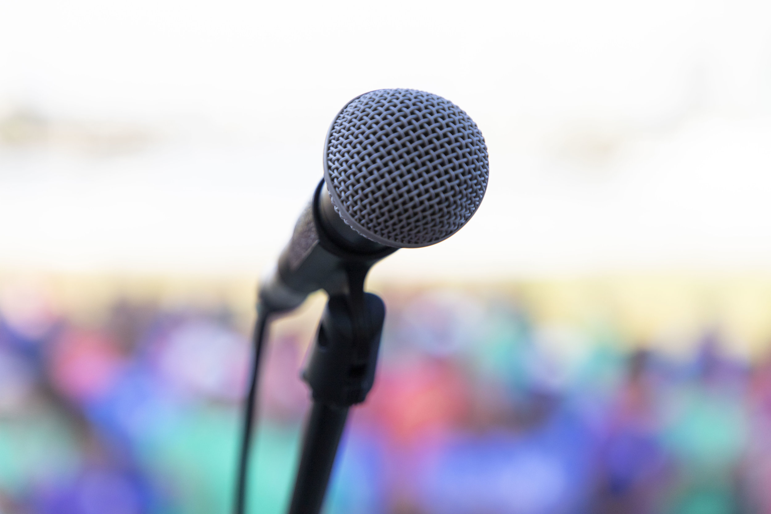A microphone in front of the assembled crowd.