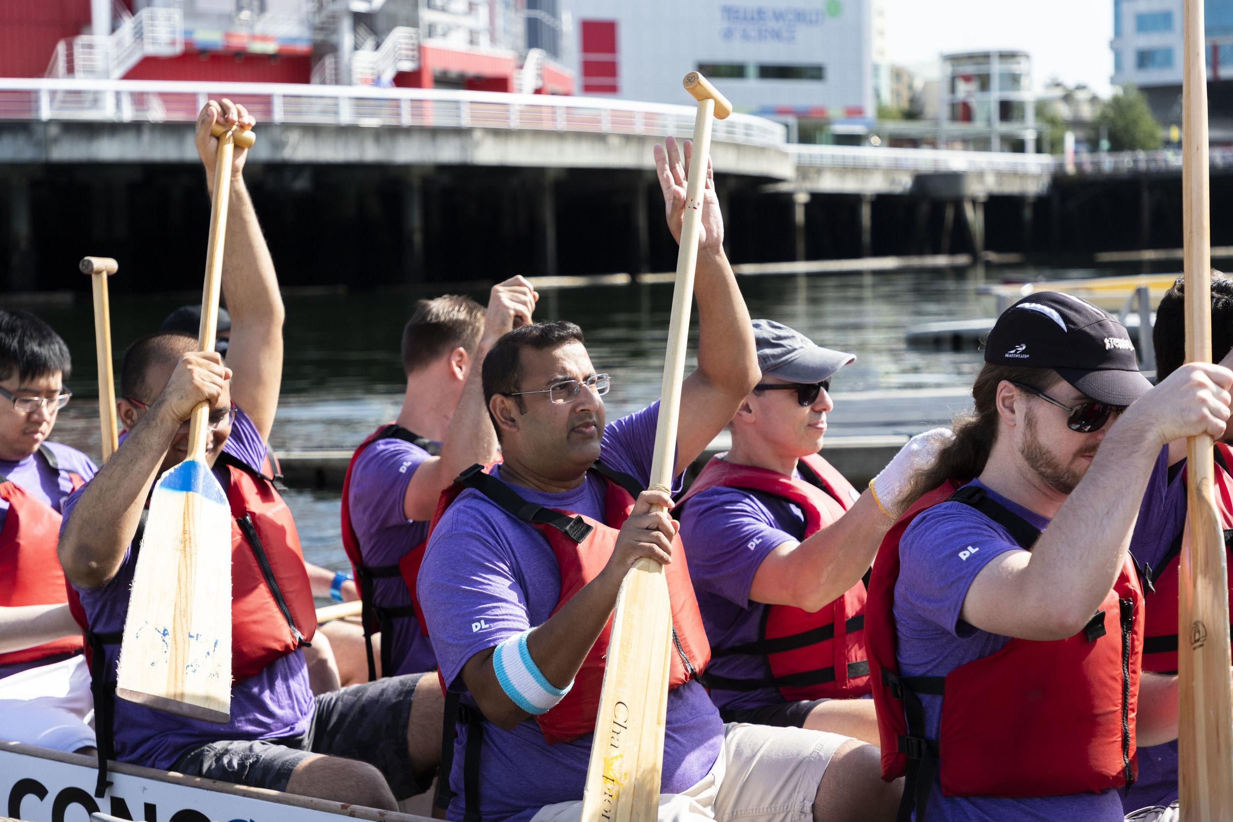 The Purple team's dragon boating crew display David Lim's impact.