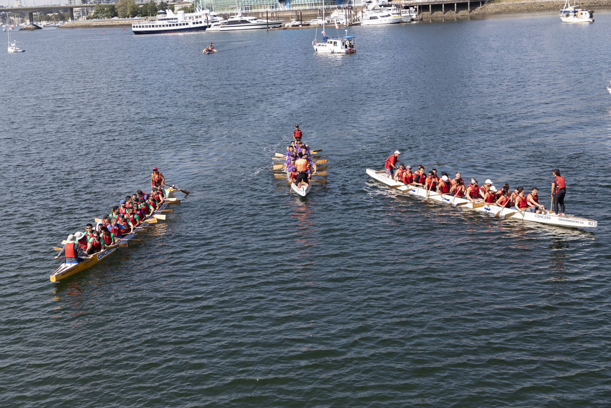 The boat crews meet in the water.