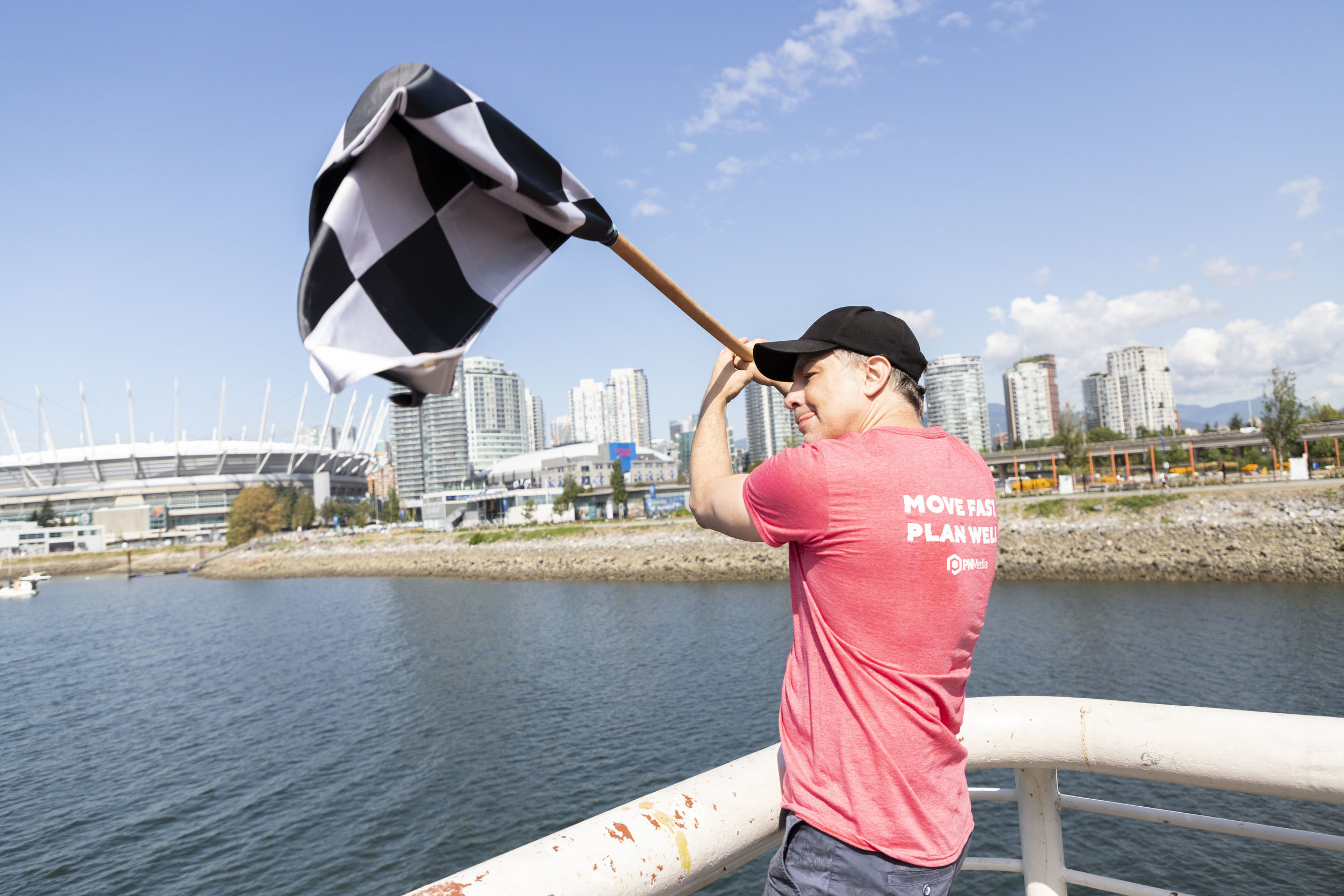 One of Mission and Values Day's organizers, Troy, waves a checkered flag.