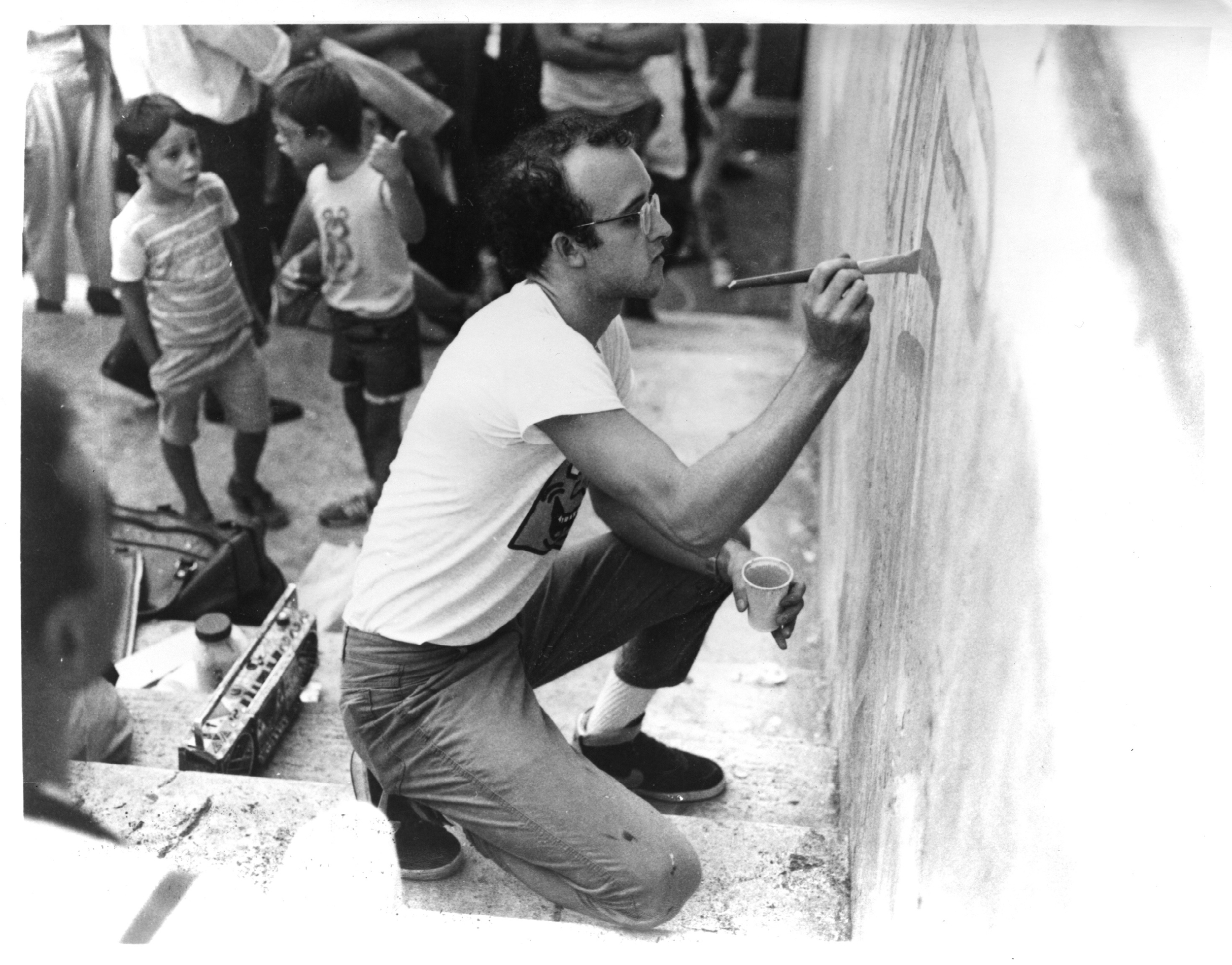 Artist Keith Haring working on a mural in Philadelphia