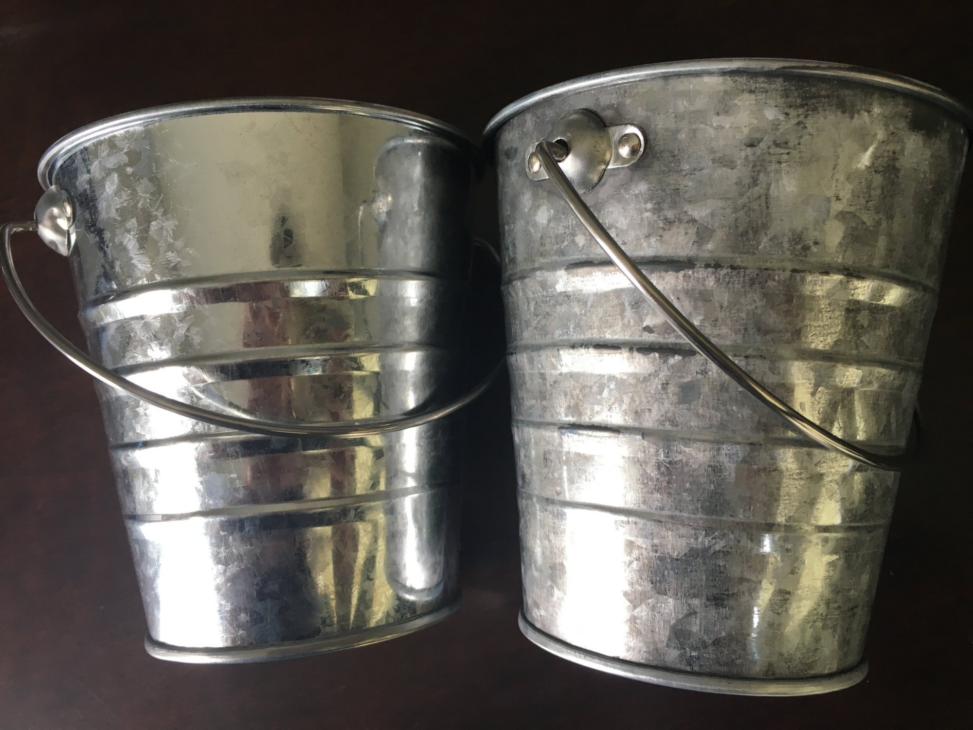 Notice the left side is shiny with my reflection. the right is duller with some browning at the top edge of the tin