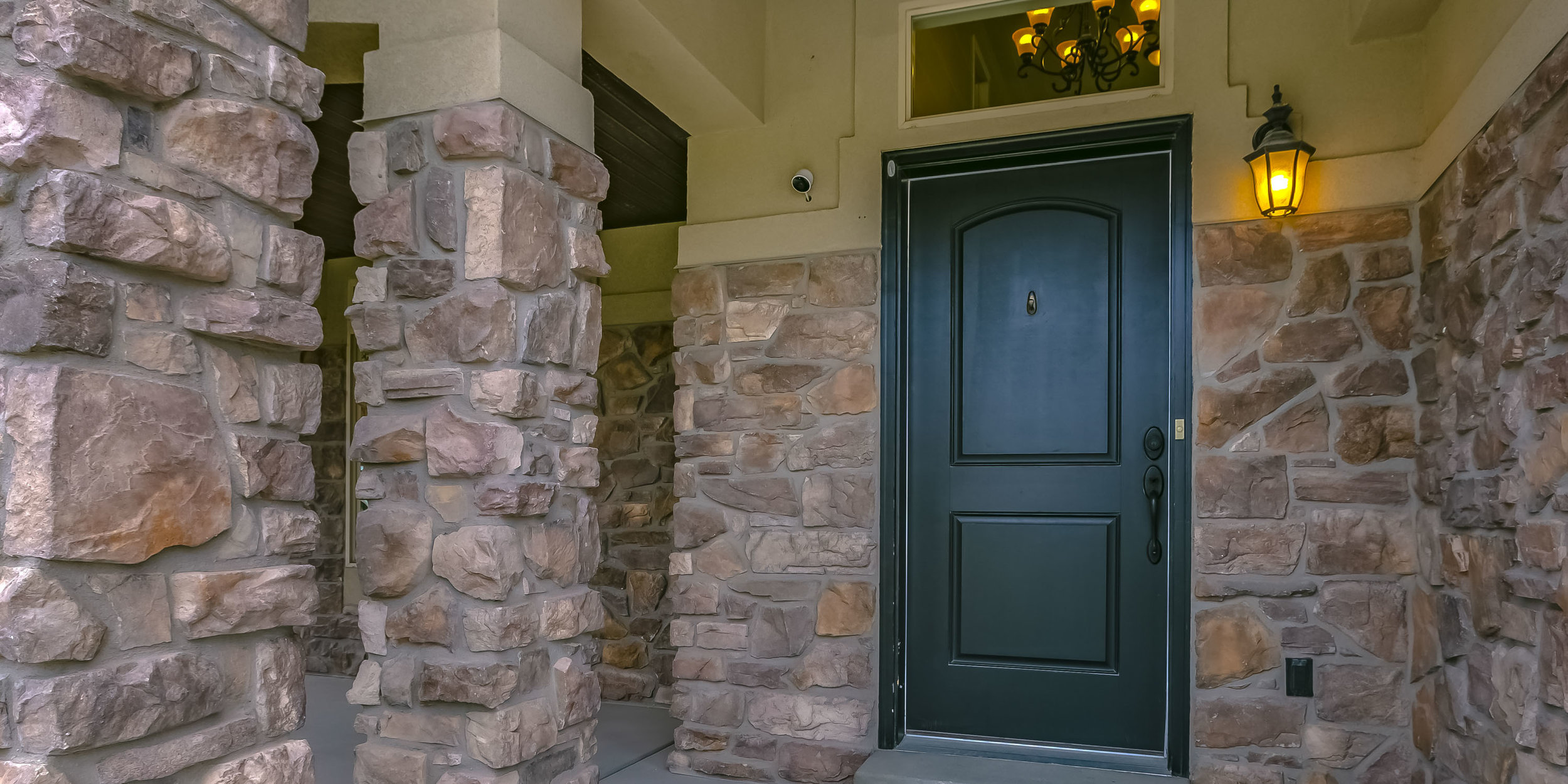 Home entrance with stone wall and porch in Utah_VA.jpg
