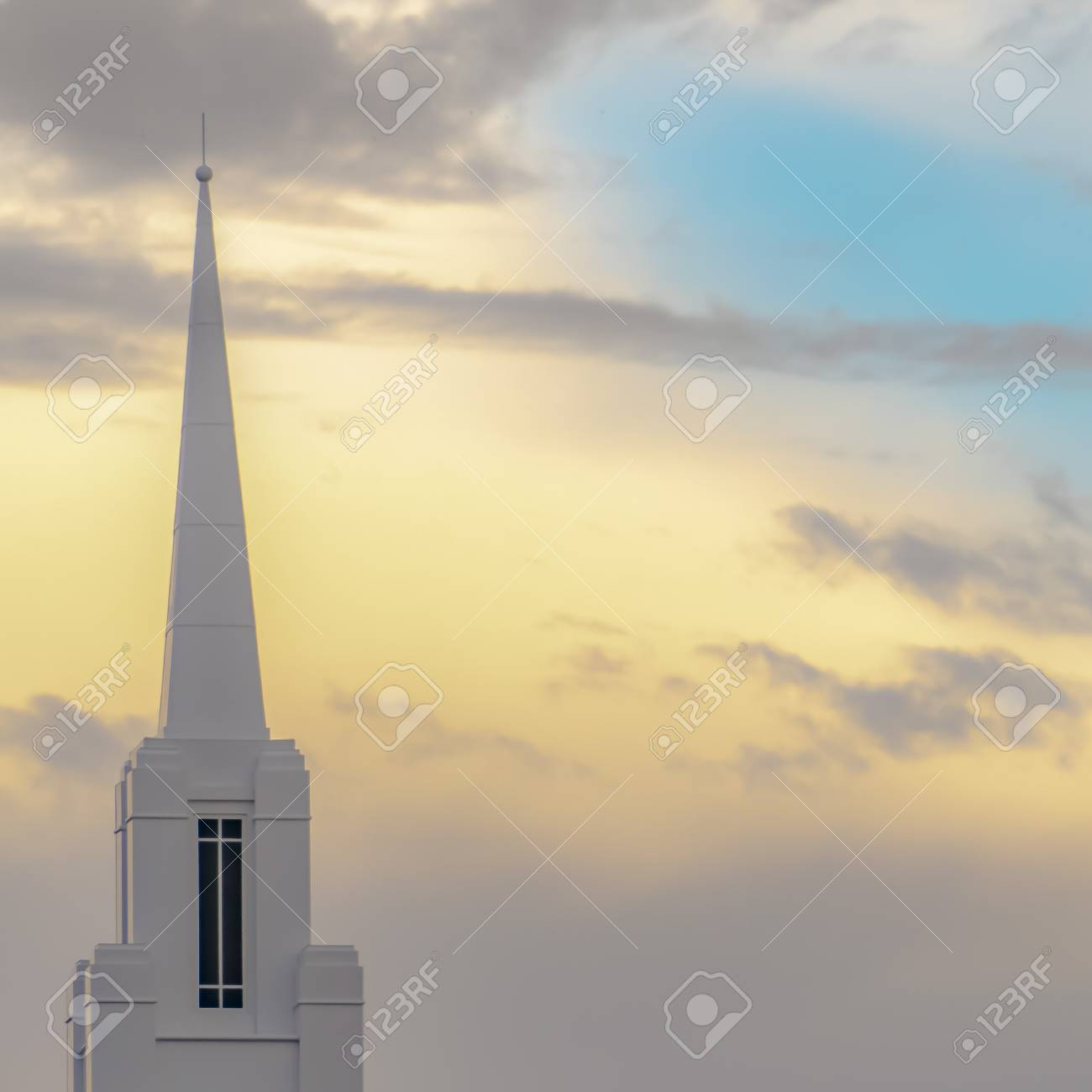 115094652-church-steeple-with-copy-space-behind-in-the-sky-the-sky-shows-pinks-purples-blues-and-golden-light-.jpg