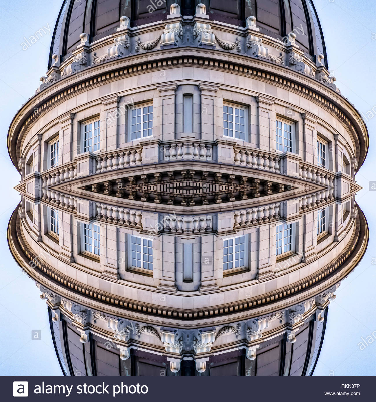 reflection-of-utah-state-capital-building-vertical-geometric-kaleidoscope-pattern-on-mirrored-axis-of-symmetry-reflection-colorful-shapes-as-a-wallp-RKN87P.jpg