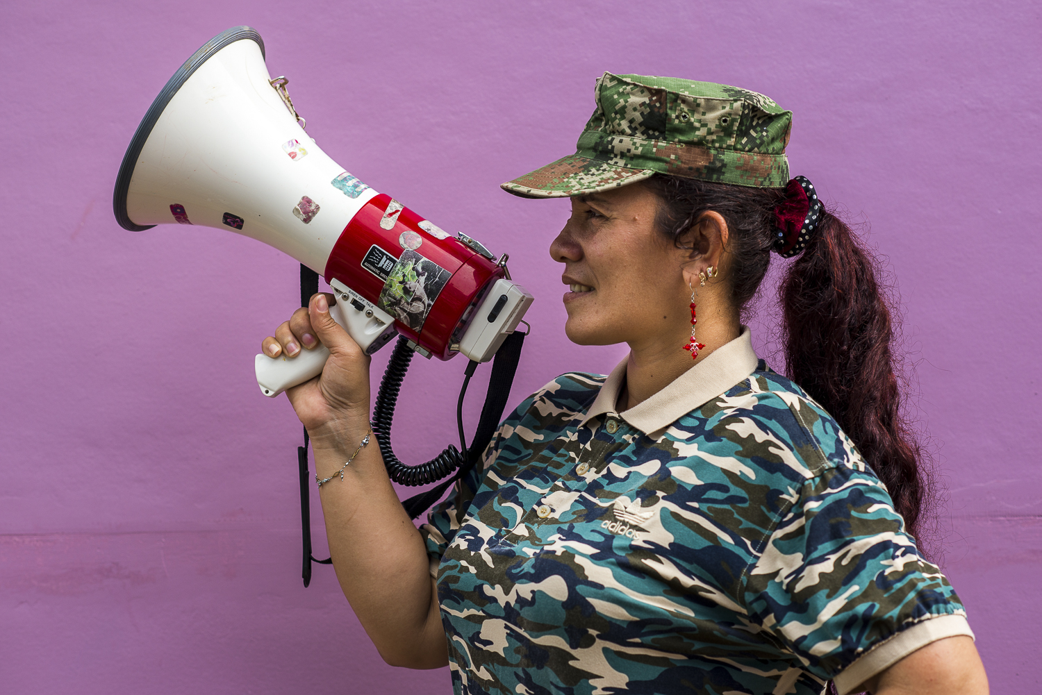 July is posing with a megaphone, used to call the guerrilleros in the extensive area.