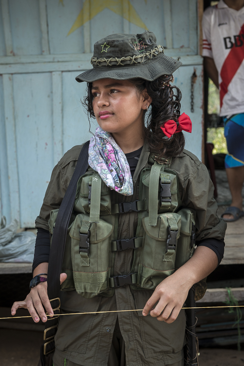 A guerrillera is waiting the FARC-EP peace delegation into the village. (January 25, 2016, Putumayo)