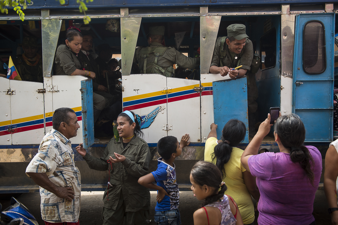 The 14th and 15th front begins their last trip to the transitional zone where they will hand over the weapons and reincorporate to civil life. On the way, they meet some friends and relatives in a village. (February 18, 2017. Caqueta.)