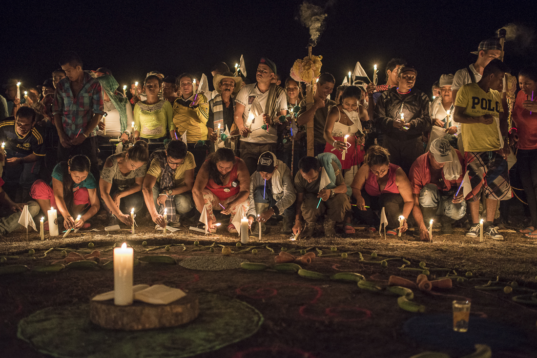 """Civilians and guerrilleros file some candles at the time of the """"vigil for peace"""" called by the FARC commanders to support the peace process after the negative voting result of the national referendum. The civilians and the social and religious organizations are invited to join the camp a night to invoke a peaceful future. (October 31, 2016. Putumayo"""