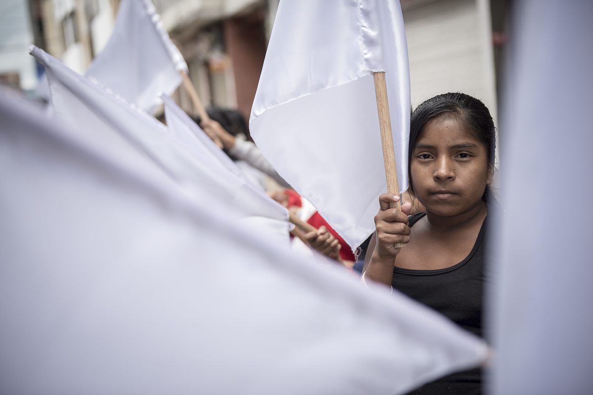 IPIALES, NARINO, COLOMBIA – FEBRUARY 25, 2018: A young girl carries a white flag, peace symbol, at the entrance of the rally where Iván Marquéz, head of the FARC electoral list for Senate, is expected. After a 53 years old war, the FARC guerrilla and the Colombian government signed the peace on November 2016. On September 2017, the guerrilla ceased to exist to become the political party FARC (Revolutionnary Alternative Force of the Common). CREDIT: Nadège Mazars for The New York Times