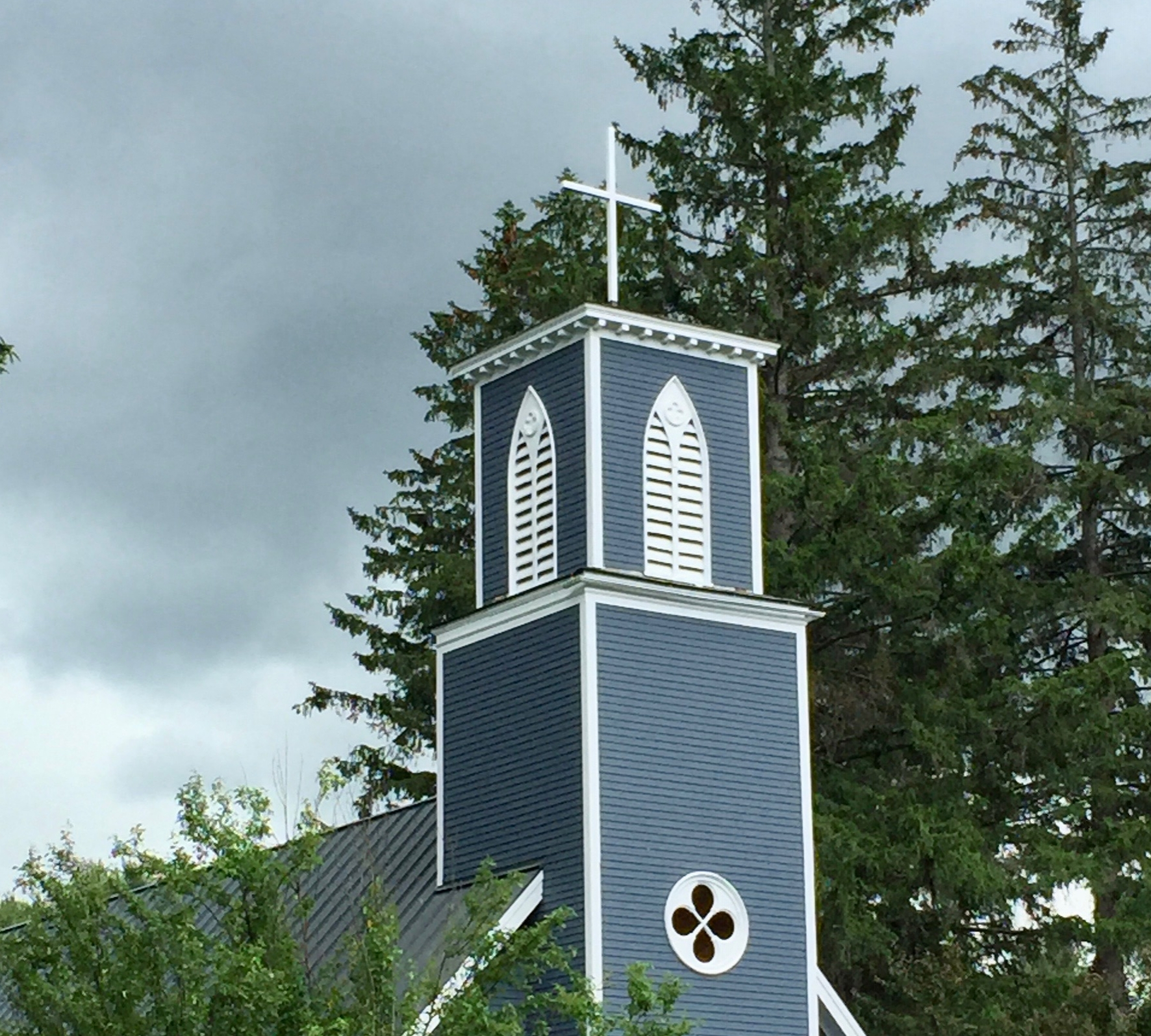 A new cross adorns our steeple.  the previous one was broken during  Hurricane Irene in 2011.