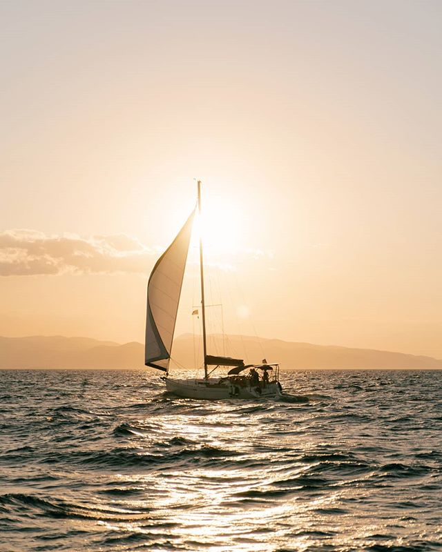 """The genoa is out and the sun is setting ⛵ ⠀ """"Happy is the man, I thought, who, before dying, has the good fortune to sail the Aegean sea."""""""