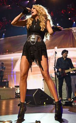 """10. Carrie Underwood:  Pictured here at the """"Apple Music Festival"""" in London, England. Carrie is wearing a nice belt designed by my talented friend  Mishka Piaf.   Instagram: @mishkapiafjewelry   The famous singer and actress became a world wide superstar after winning season 4 of American Idol.Underwood released her first album, """"Some Hearts"""", in 2005, which soon became the fastest selling debut album by a Country singer, winning her 3 Grammy awards. The singer has since been on 4 world wide tours and is set to head out on her """"Storyteller"""" Tour in the new year.She sits at #10 on our list with a net worth of $45 million."""