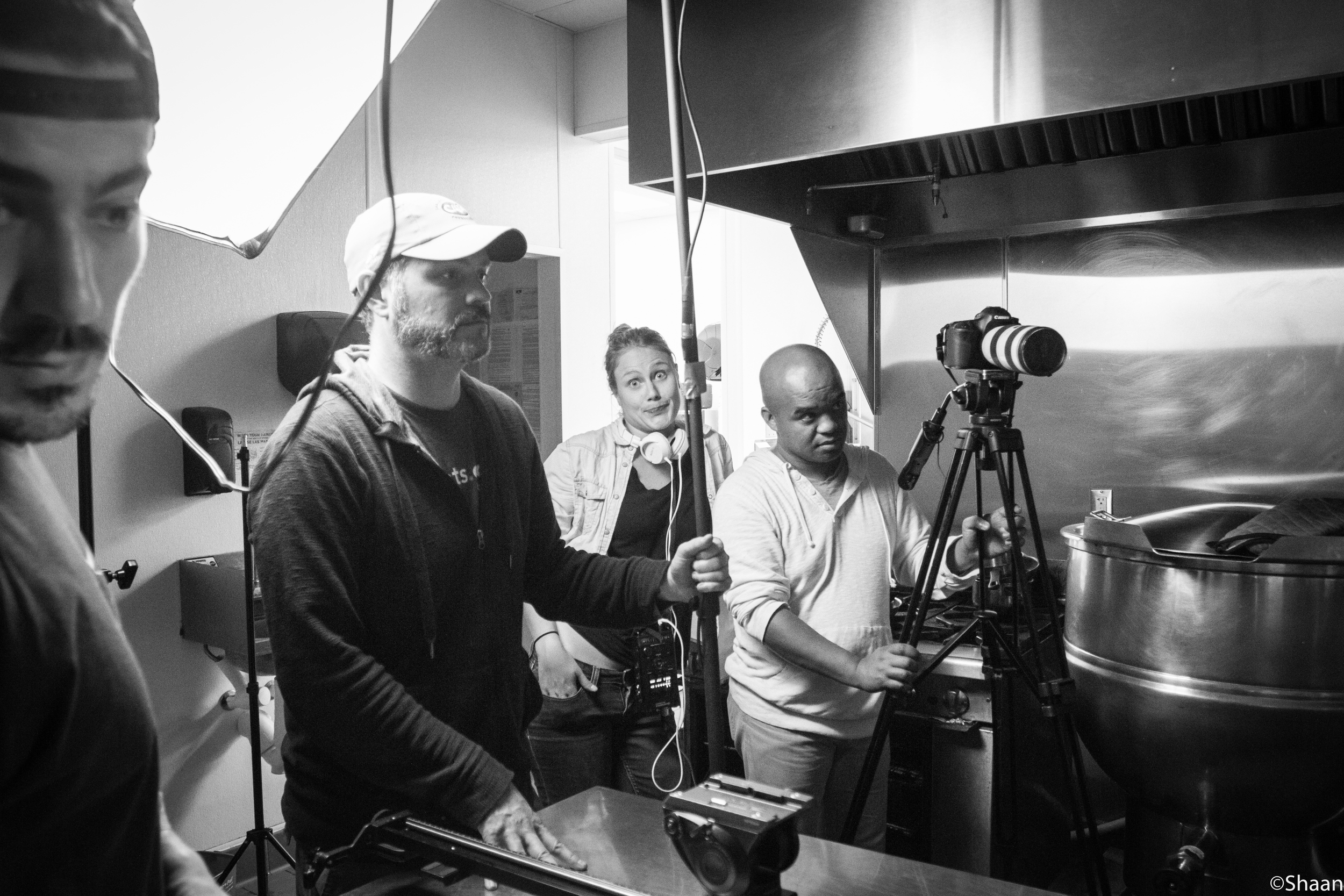 Producer Michael S. Mauger, Editor Alix Duchene, and Director of Photography David Brooks prepare for the next take. (Photo: Shaan Couture)