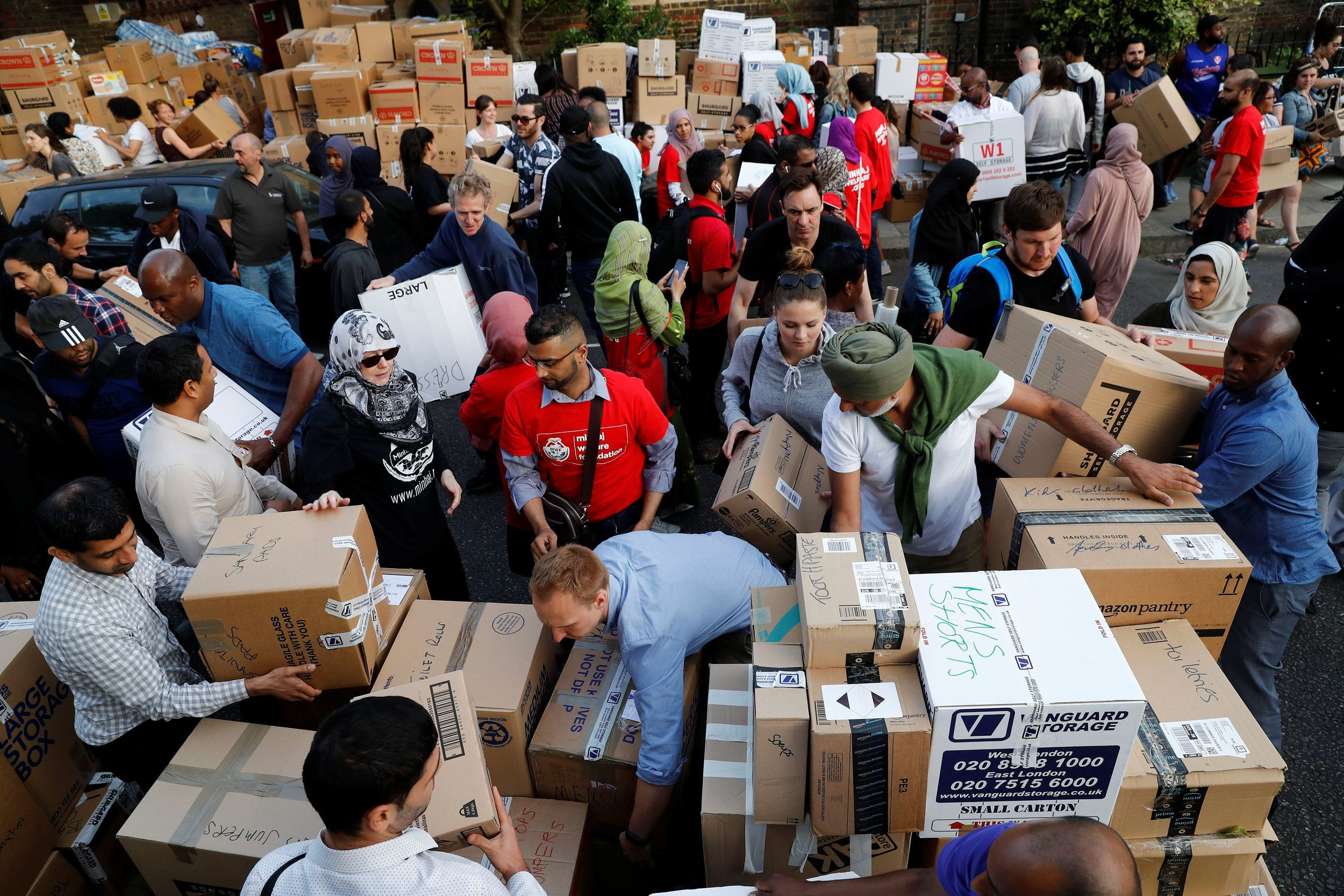 LEAD-1-Grenfell-charities-Volunteers-prepare-supplies-for-people-affected-by-the-Grenfell-Tower-block-in-north-Kensington-West-London-June-15.jpg