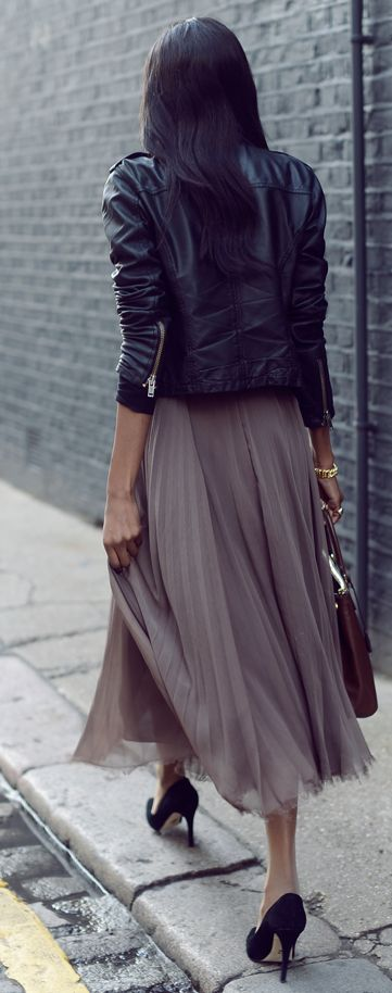 Pleated skirts are everywhere this season, especially in  midi length flowy silhouettes . Whether it's in  jewel tones or  classic black , we love how they look paired with a statement pump or a high heeled bootie. Longer pleated skirts can create a lot of volume so we like to keep the top simple and fitted. A  classic slim-fitting crew neck sweater , a slinky tank, a tailored long sleeve blouse or a  slim leather jacket work perfectly.