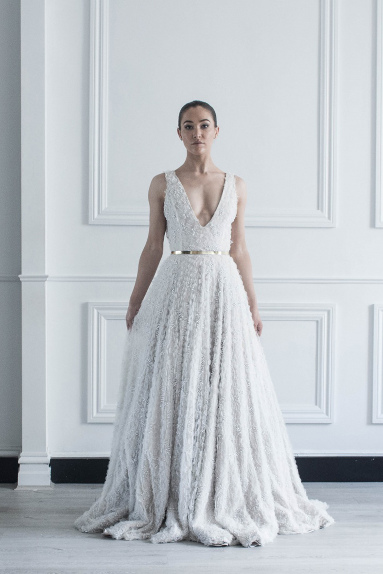 02. CHOSEN BY ONE DAY  .  The stunning pearl covered and flowing Camelia gown immediately caught our attention. Classic yet still fun and playful.